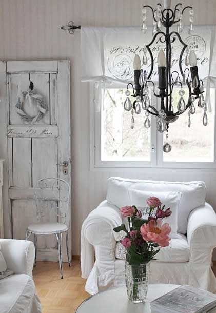 Shabby Chic white slipcovered chair ~ check; whitewashed wood ~ check; shabby chandelier ~ check; fresh flowers ~ check...