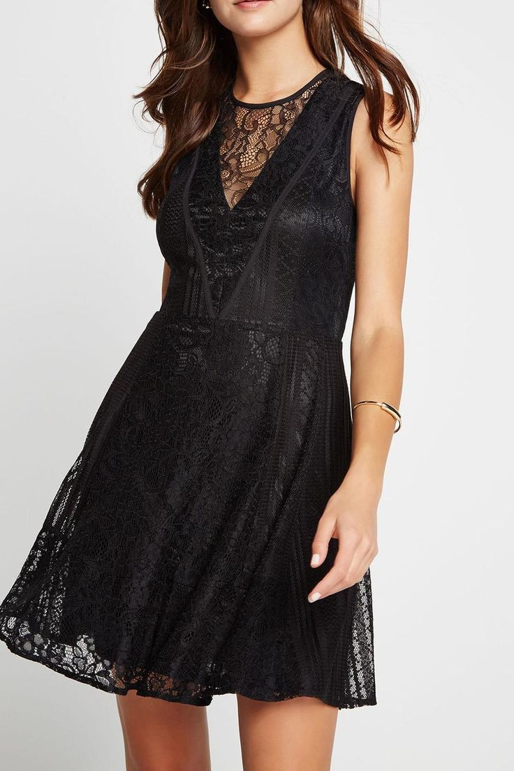 Mixed lace fit-and-flare dress. High rounded neckline, open back detail, and seamed waistline.   Lace Fit Flare Dress  by BCBGeneration. Clothing - Dresses - LBD Clothing - Dresses - Lace Oregon