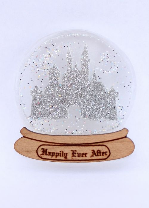 ACQUIRED Add a bit of magic and sparkle to your outfit with our Happily Ever After snow globe brooch.