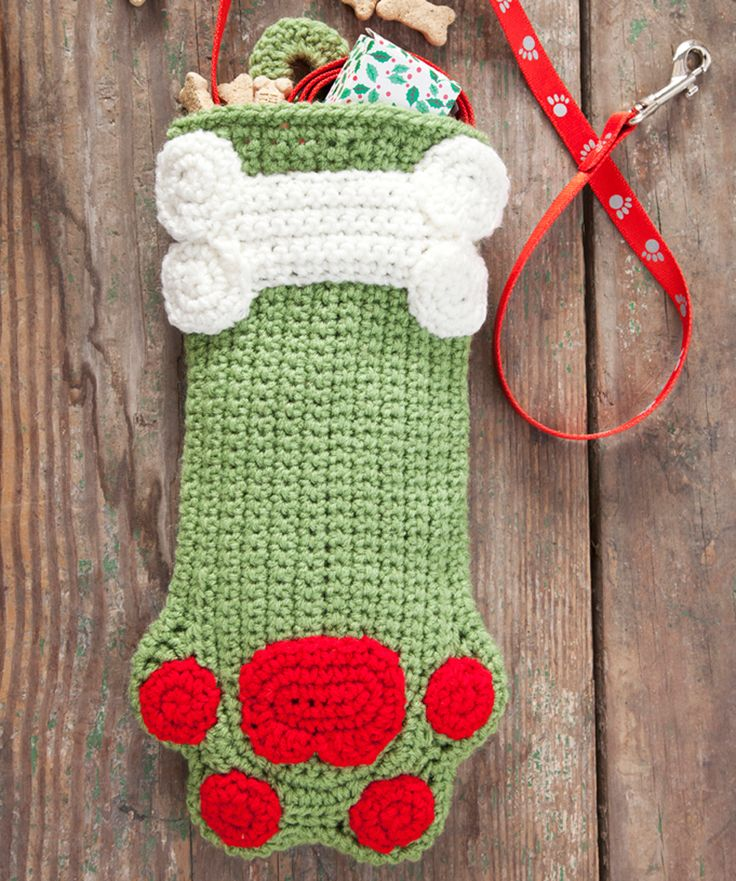 Dog Paw Christmas Stocking crochet pattern. This took me the longest time because your count needs to be spot on the whole way through. Mine didn't turn out quite as nice as this, but still looks pretty good if I do say so myself. There's a cat paw version that's almost identical and I might give that a try. Wouldn't want kitty to feel left out. :)