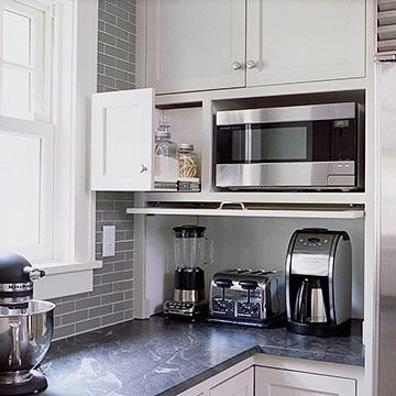 In the same vein, unobtrusive appliance garages -- countertop doors that swing up instead of rolling up -- and cabinet inserts are designed to stow everything from mixers to coffeemakers