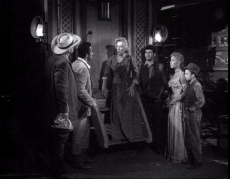 """From the 5 April 1962 episode of Frontier Circus titled """"Mightly Like Rogues.""""  The children (Joby Baker, Jena Engstrom, and Roger Mobley) have confessed their crimes to the circus owners (Chill Wills and John Derek) and they catch Ma Jukes (Glenda Farrell) coming from the colonel's office with the money she has stolen from the safe."""