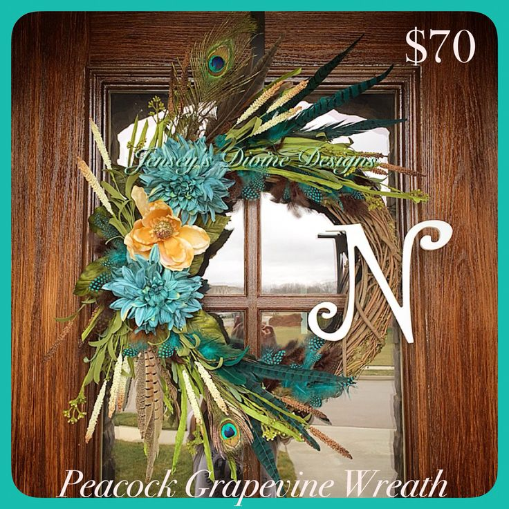 This wreath is filled with a variety of greenery, two genuine peacock feathers, flowers and beautiful blue and brown feather accents