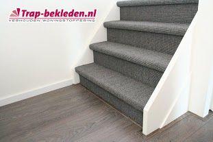 Foto van dichte trap met grijs/ antraciete sisal. Modern en robuust