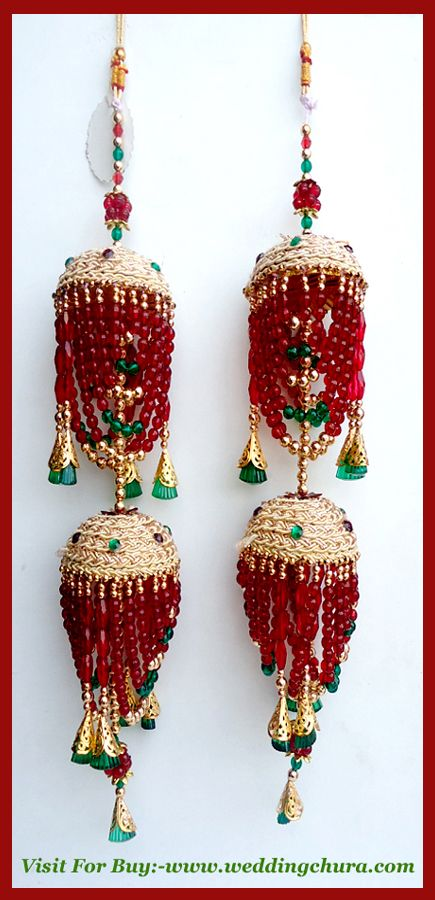 """Briefing about wedding kalire is these are hanging ornaments worn on the both  hands, chura ke niche wear kiye jate hai . yeh  usually friends or sister-in-law tie Kalire to bride's hands. They hang like look beautiful flower and come in a variety of colors to match bridal lehenga . """
