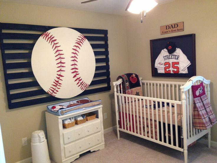 Baseball Nursery; My husband played ball at Auburn. We hung a curtain over the window (not pictured) with a golf club using two oil-rubbed bronze command hooks. Bedding purchased at Babys-R-Us, pallet project is homemade, the jersey is in a shadow box, and the 'Dad' sign was purchased at Kirklands.