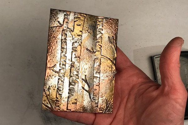 Impressions of Tarnished Foil Tutorial - Splitcoaststampers An interesting technique.