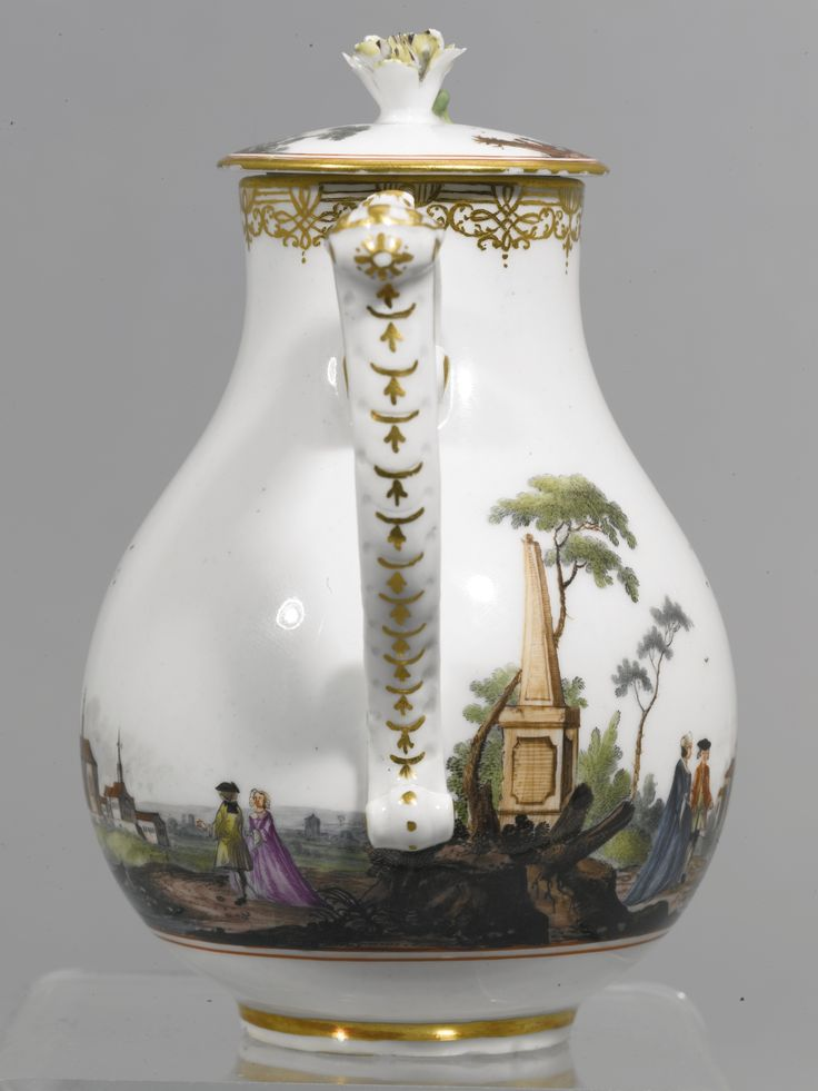 A MEISSEN MILK JUG AND COVER, CIRCA 1740 of pear shape affixed with a scroll spout and wishbone handle, painted with a continuous scene of European figures in a landscape, over concentric iron-red circles, gilt scroll border at the rim, the cover surmounted with a flower finial, crossed swords mark in underglaze-blue, gilt 52.L. to both,