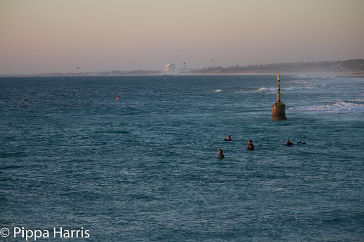 Auto ISO 200 f/5.0 1/200 109mm The iconic Cottesloe bell. I like the clarity of the bell in amongst the sea haze, and the sun reflecting on Ob City in the distance. I think the kite surfers and surfers give the shot a little bit of action and expectancy. Thoughts?