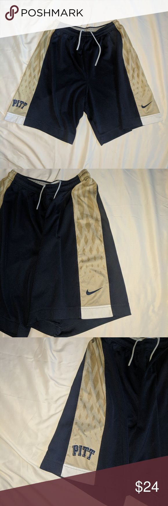 Nike PITT Panthers NCAA Basketball Jersey Sz XL Item Name: Nike Pitt Pittsburgh University Panthers NCAA Basketball Shorts  Specific Design: Blue / White / Gold / Net Side Design / PITT Spell Out on side / Nike Swoosh Side Logo / Drawstring & Elastic Waist  Item Condition: Excellent!  Size: XL  Immediate and clean shipping! Nike Shorts Athletic
