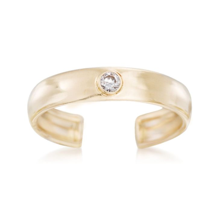 Who knew one tiny accessory could make such a major impact? Our polished 14kt yellow gold adjustable toe ring boasts a singular CZ accent at the very center. Minimal, chic and right on trend, you'll look fashion-forward everywhere you go...from a backyard barbecue to a summer beach party! 14kt yellow gold toe ring. Free shipping & easy 30-day returns. Fabulous jewelry. Great prices. Since 1952.