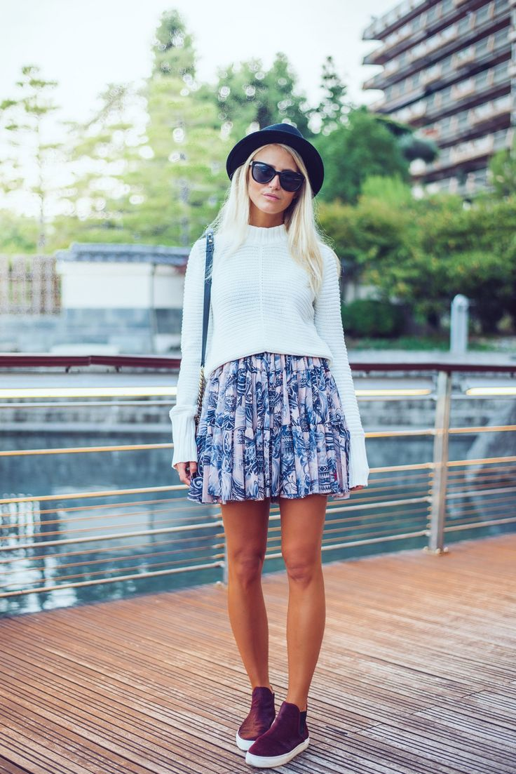Janni Deler is wearing a hat bought in London, sunglasses from River Island, white knit jumper from Gina Tricot, patterned print skirt from Lindex and the shoes are from Zara