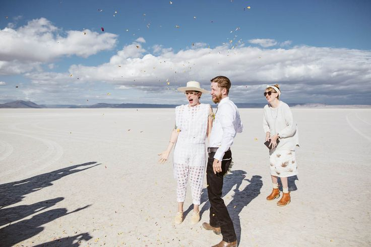 """Sarah & Sage's minimalist and intimate wedding took place in the middle of Oregon's Alvord Desert where the couple said """"I do"""" with friends and a campfire."""