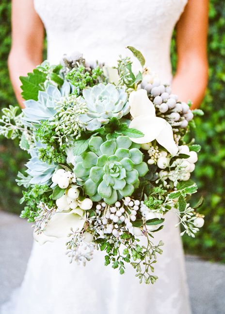 Succulents and berries.  Perhaps a bit heavy to carry, but a really great flower arrangement idea.