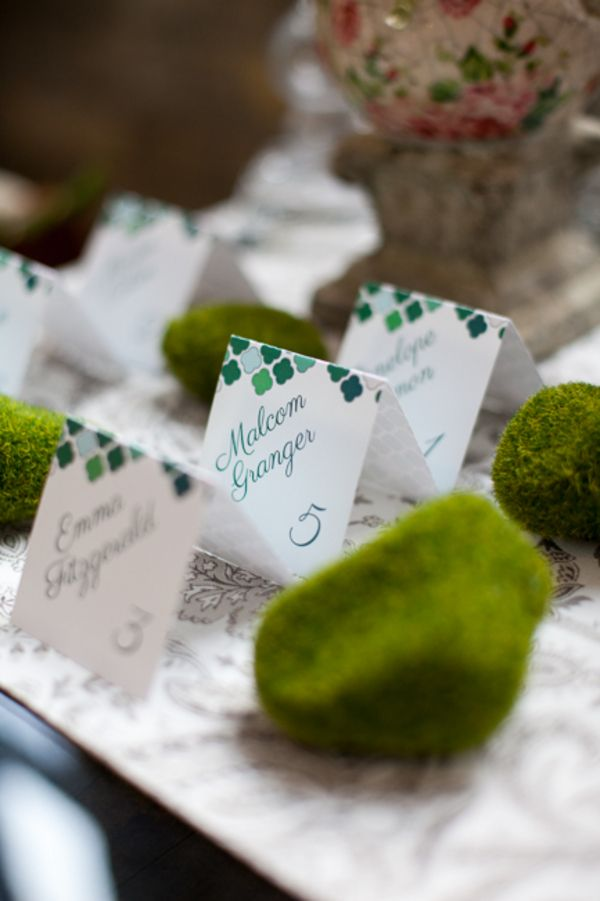 printable wedding place cards vintage%0A Geometric patterned escort cards with green script  displayed alongside  mosscovered rocks  Photo