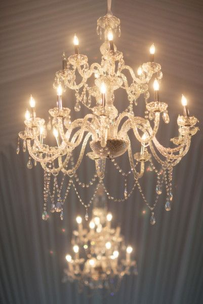 Exceptionally elegant lighting for a glam wedding. Absolutely loving these chandeliers {Michelle Kim Photography}
