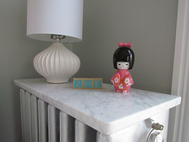Turn a radiator into a shelf w/ piece of marble or an old marble mantle top.