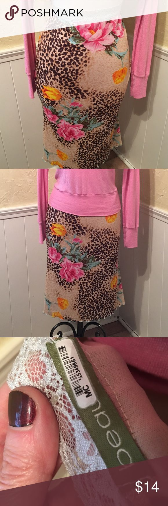 Printed Midi Skirt with Elastic Waist Printed Midi Skirt with Elastic Waist. Cheetah background print with bright pink roses. Very comfortable material and in good condition. beau bois Skirts Midi