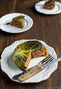Vegan Chou Farci (Cabbage Stuffed with Barley and Lentils) -  1/2 c pearl barley (other large grains, such as farro, may be used) 1 1/2 c water (or vegetable broth) 1 tsp vegetable bouillon or 1 bouillon cube (if water is used) 1 medium onion 2 carrots 1 1/2 cup cooked lentils (green, brown, or black) or 1 15-ounce can 4 cloves garlic 1 tsp thyme 1 bay leaf 1 tsp sweet smoked paprika 1 tsp  cumin 1/2 tsp ground ginger 1/4 tsp allspice 1/4 tsp cayenne pepper 1/2 c tomato sauce 1 large cabbage