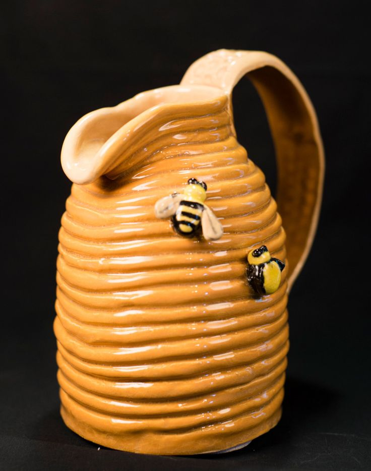 A personal favorite from my Etsy shop https://www.etsy.com/listing/294159955/handmade-coil-pottery-beehive-pitcher