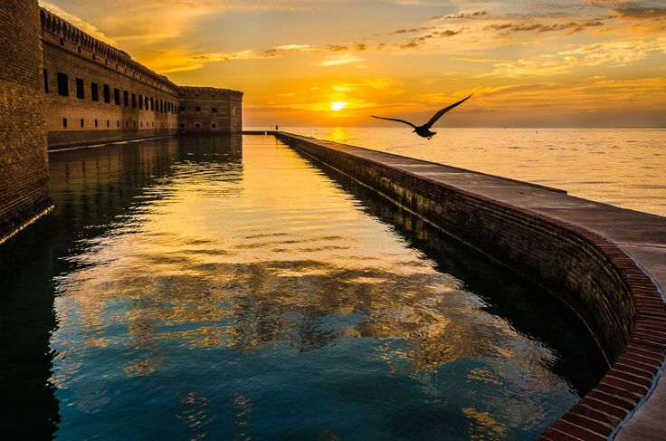 Though it's a national park, Dry Tortugas is somewhat of a hidden gem for Florida, less than 100 miles from Key West. The seven small islands that make up the park are accessible by boat, and the waters here are crystal blue, with vibrant coral and marine life that you can check out by snorkeling. When you're done swimming in the water—or relaxing on the beach—visit Fort Jefferson, one of the country's largest 19th-century forts.