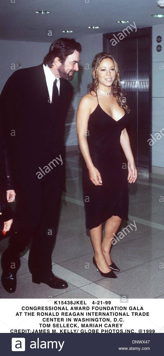 Download this stock image: Apr. 21, 1999 - K15438JKEL 04/21/99.CONGRESSIONAL AWARD FOUNDATION GALA.AT THE RONALD REAGAN INTERNATIONAL TRADE.CENTER IN WASHINGTON, D.C..TOM SELLECK & MARIAH CAREY. JAMES A. KELLY/ 1999(Credit Image: © Globe Photos/ZUMAPRESS.com) - dnwx47 from Alamy's library of millions of high resolution stock photos, illustrations and vectors.