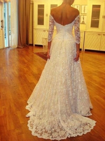 off the shoulder straight neckline sleeves princess lace wedding dress. $328.00, via Etsy.