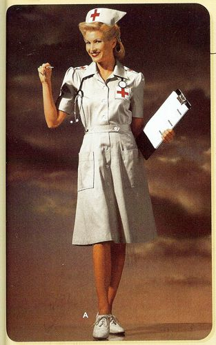 WWII Nurse in full regalia (I had a uniform just like this, minus the crosses, and wore it into the '90s)