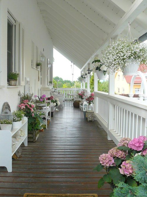 I dream of having a porch like this one day...  One of the huge wrap-around ones on an older farmhouse or New England home with old shutters