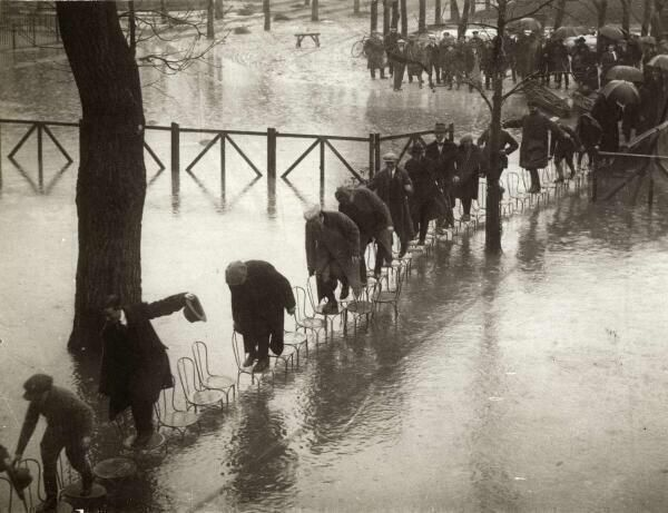 Parisians find a way to keep their feet dry after a flood of the Seine in 1924.