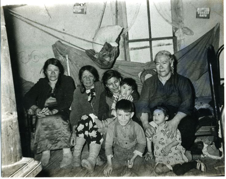 nōhkum Adeliene Half – holding Louise and her brother Peter sitting on the floor with a happy face, her aunt Elizabeth Large holding her cousin Martin Half and the Desjarlais cousins.