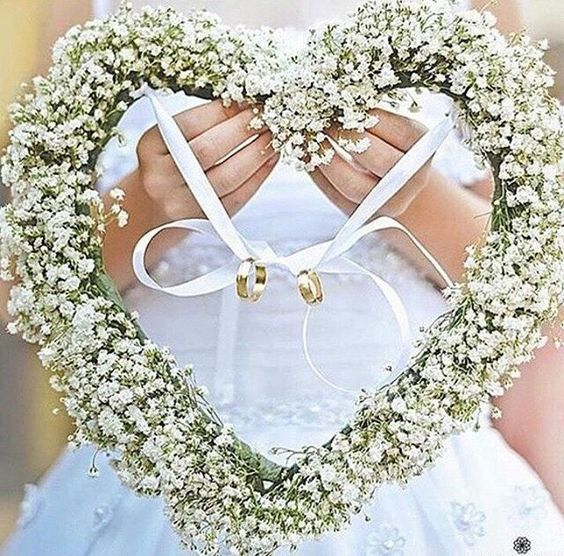 Wants something different than the usual ring box as your ring bearer? Perfect for outdoor weddings, we are swooning over this lovely idea of heart shaped floral arrangement that evokes a rustic yet feminine vibe. With the additional white ribbon to tie up the rings together, this will be a great alternative for brides who wants a unique twist to their nuptials. Photography via @weddingdream. Who's inspired? Show some love!: