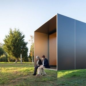 MIMA+Light+is+a+small+prefabricated+house+raised+up+from+the+landscape+on+a+near-invisible+base