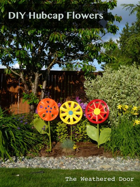 Add a quirky touch to your garden by spray painting hubcaps and embellishing them with other household items like broken shovel handles as stems.  Get the tutorial at The Weathered Door.   - CountryLiving.com