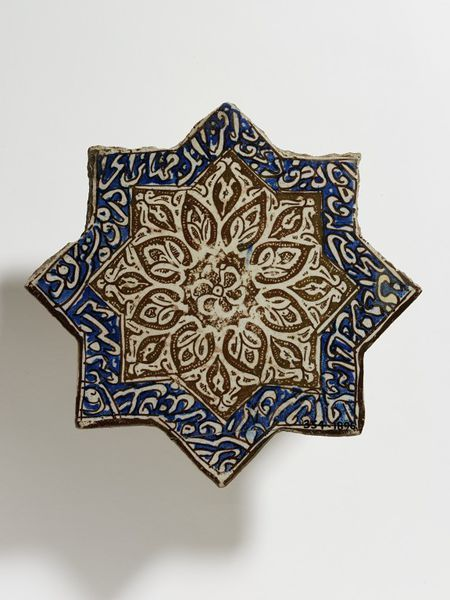 Tile Place of origin: Kashan, Iran (made) Date: ca. 1300 (made) Artist/Maker: unknown (production) Materials and Techniques: Fritware, painted with lustre over the glaze Museum number: 354-1896