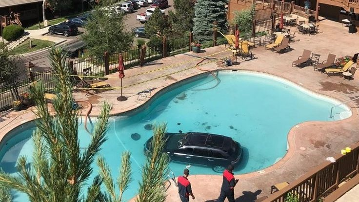 Car plunges into Colorado Springs swimming pool https://tmbw.news/car-plunges-into-colorado-springs-swimming-pool  A Colorado woman sent her car plunging to the bottom of a swimming pool after reportedly putting her foot on the accelerator instead of the brake.The accident happened at the Cheyenne Mountain Resort country club in Colorado Springs on Monday morning.Reports said the car hit another vehicle and drove at up to 60mph (97km/h) up a hill, through a fence and into the pool.The…