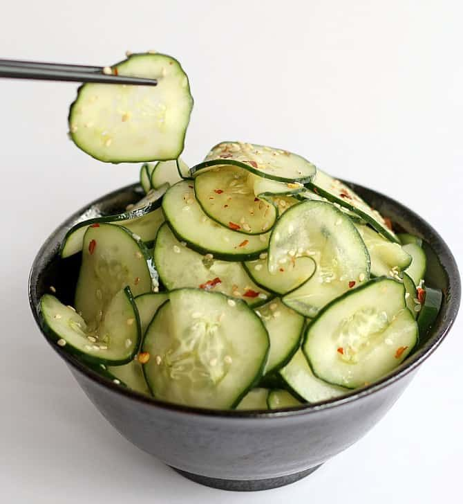 This is a simple Cucumber Sesame Salad. Rice wine vinegar, soy sauce and sesame oil mix with sugar and crushed red peppe…