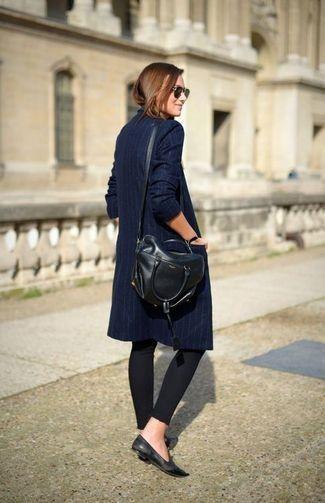 Women's Black Leather Satchel Bag, Black Leggings, Black Leather Loafers, and Navy Vertical Striped Trenchcoat