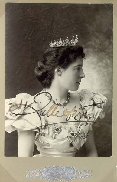 A belle epoque diamond and sapphire tiara, circa 1880, worn by Lillie Langtree. Designed as a series of thirteen diamond and sapphire motifs, with smaller diamond spacers.