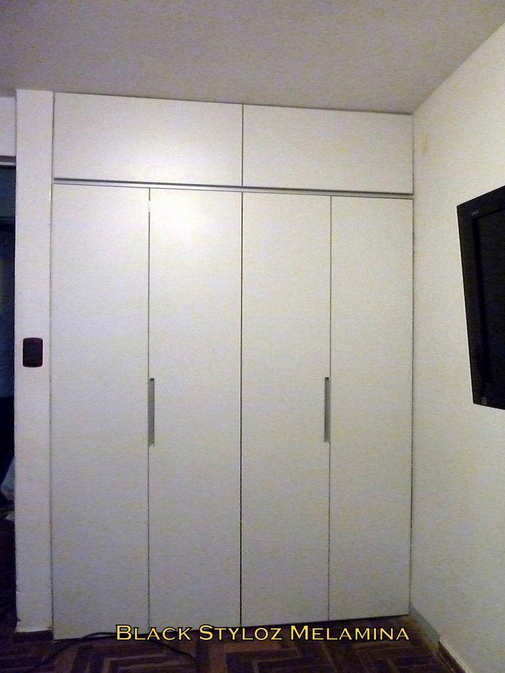 Closet placard con puertas plegables en melamina blanca for Puertas de dormitorios modelos