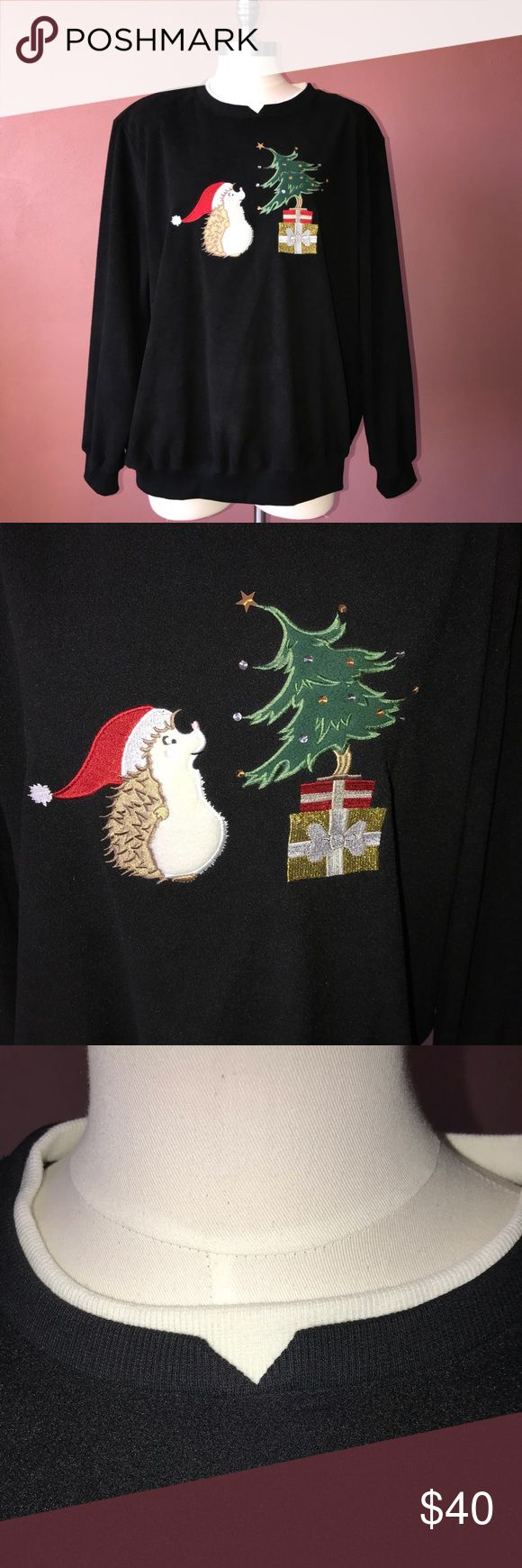 Alfred Dunner Christmas sweater -black sweater -Adorable graphics on the front -sequins on the Christmas tree -white under-collar -small v shape in the neck -perfect condition -Size 2x Alfred Dunner Sweaters