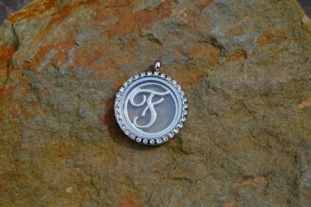 These stunning initial disc's are a real focal piece and will stand out in your locket. Pick the initial and maybe add some birthstones, to personalise it to your taste.  http://silverhavenjewellery.com/products/243554--monogram-locket.aspx