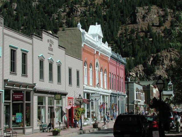 Georgetown, CO. west of Denver, Georgetown is a delightful Victorian village set in a spectacular mountain valley with 200 restored buildings from the 1870's. The main street has shops and restaurants and many of the old homes have been turned into antique stores. The Georgetown Loop Railroad operates in the summer months with narrow gauge steam locomotives curling down a mountain ledge, at one point crossing over a 90-foot (27 m) high trestle.  Via I-70 W 45.54 mins