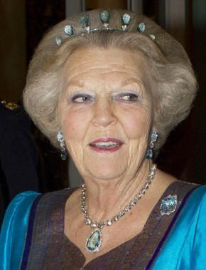 HM queen Beatrix of the Netherlands wearing pieces from the aquamarine parure (tiara, one of the pairs of earrings, one of the brooches, and the pendant on a diamond collet necklace).