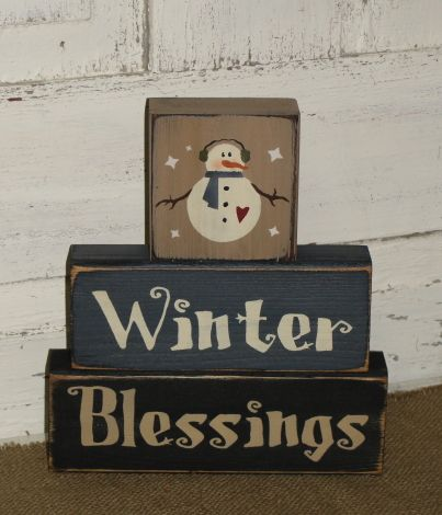 This Winter Blessings primitive wood snowman stacking block set will make a nice shelf sitter accent for your Christmas and winter holiday home décor. I have painted this set tan, blue and black with black underneath the topcoat for more of a primitive look.  (Also shown in burgundy middle block)  They have been distressed over the entire blocks.  Measures approx. 8 x 9 high