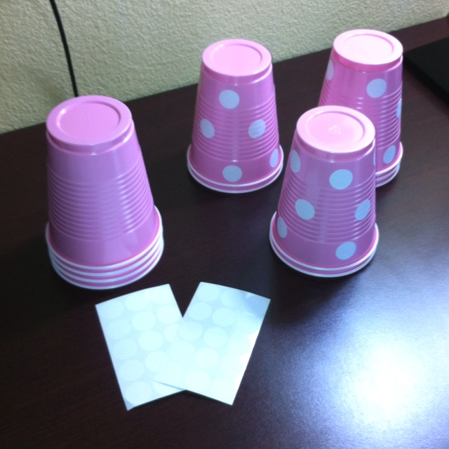 Having a Minnie Mouse/polka dot party. I could not find big cups to match,so we made our own:) Pink cups and garage sale circle stickers.
