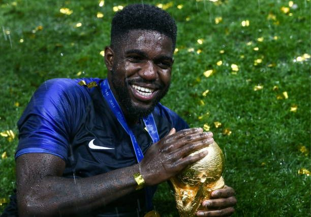 France S Samuel Umtiti Holds The Trophy During An Award Ceremony After The 2018 Fifa World Cup Final Match Between France Awards Ceremony Fifa World Cup Trophy