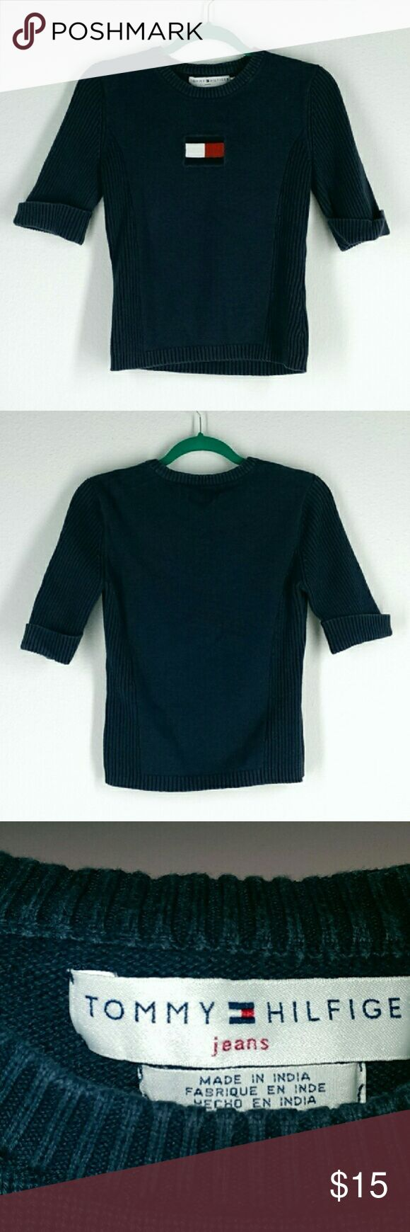 """Ladies Tommy Hilfiger Short Sleeve Sweater top M Short  to mid Sleeve Tommy Hilfiger knit sweater in navy blue with logo design on the front. Sleeves have a half rolled up look. Measurements: Chest - 16"""" Length - 21"""" Sleeve - 11"""" Tommy Hilfiger Tops"""