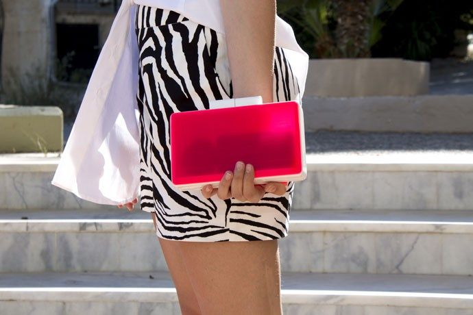 Black and white is always the safest and most chic choice when it comes to weekends and long walks by the sea. Finding elegant and unique pieces like this zebra print pair of shorts always makes my day especially when their brand, Lola, is a Greek one! And so is Urania Gazelli, the designer behind this extraordinaire fluo clutch bag that adds the right amount of color to this look. Definitely a go to outfit for all day long!