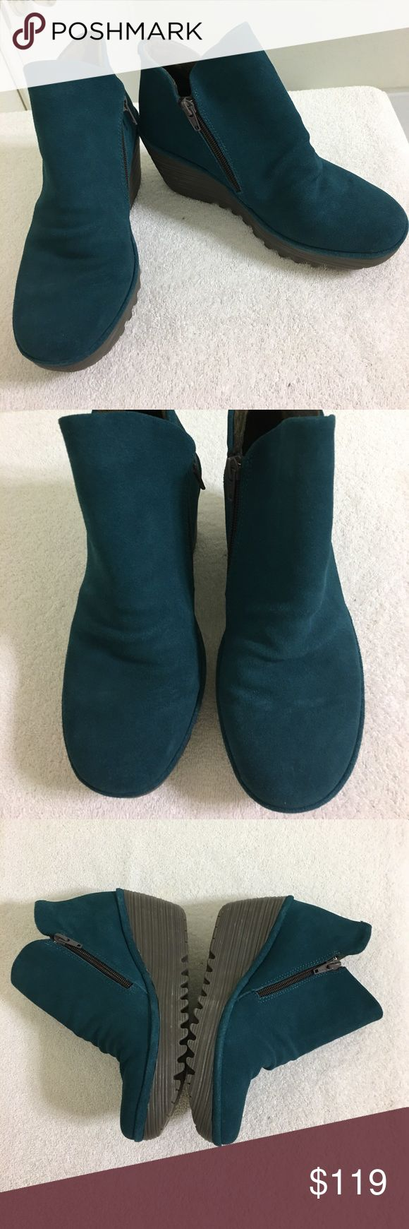 NEW FLY LONDON 'Yip' Teal Wedge Suede Ankle Bootie NEW FLY LONDON 'Yip' Teal blue Wedge Suede Ankle Booties for Sale.  Size 37 (Fit like a 6  - 6.5 rather than 6.5 - 7). Super cute & great color!  Selling because they are a bit too small for me.  New without tags.  Purchased from Nordtrom Rack.  They have been tried on, however still new in great condition.  Very cushiony! Fly London Shoes Ankle Boots & Booties